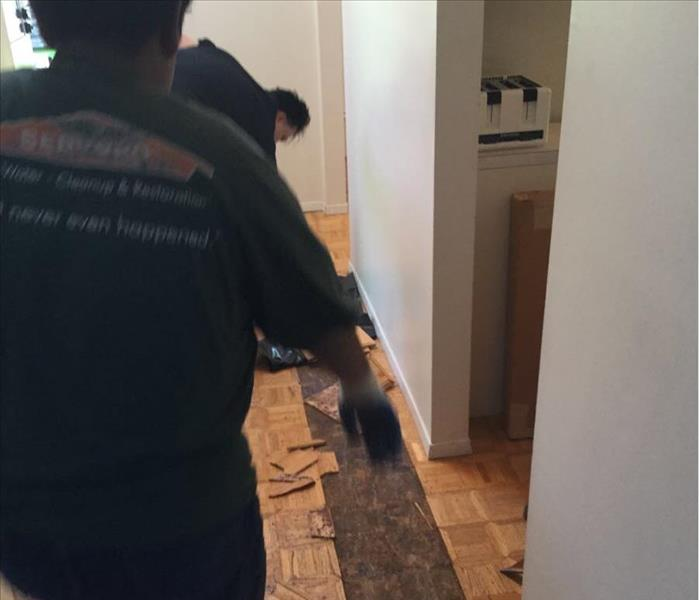 strip of parquet removed for drying of subfloor