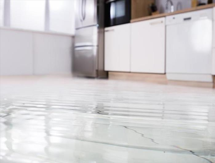 floor covered with water in kitchen