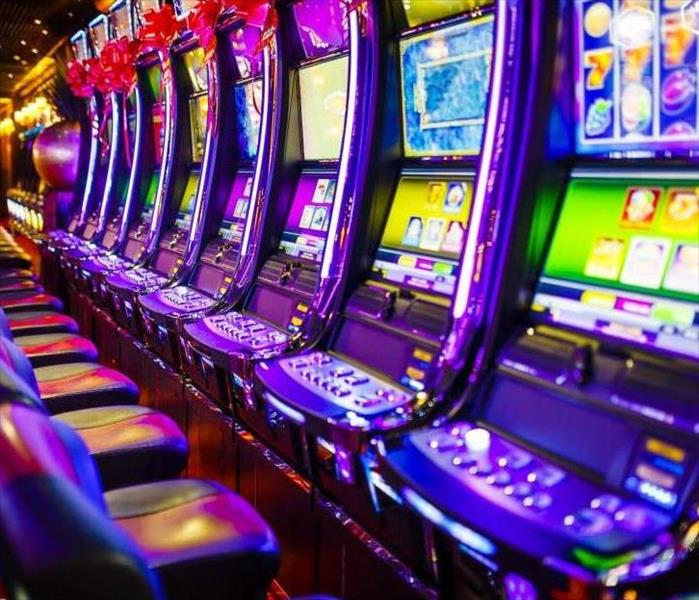 line of electronic slot machines in casino